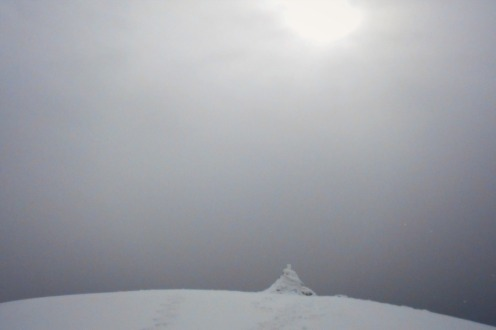 The summit within reach, snow sets in